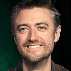 Sean Gunn - Bildurheber: Von steve cranston - https://www.flickr.com/photos/graffio_studios/15703030093/, CC BY-SA 2.0, https://commons.wikimedia.org/w/index.php?curid=38027407
